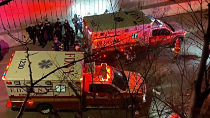 USA: Bus dangles from Bronx overpass after crash