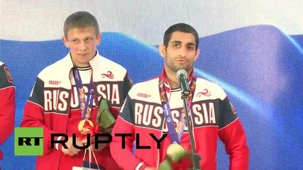 Azerbaijan: Russian wrestlers parade European Games gold medals