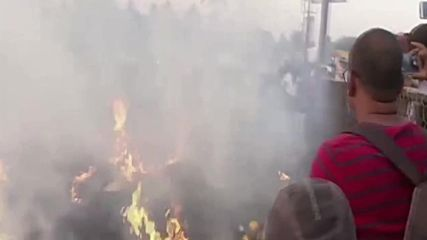 Burnin' beef! Cows, sheep and people jump over open flames for Indian harvest