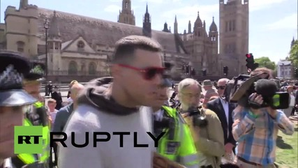 UK: Police detain two men during State Opening of Parliament event