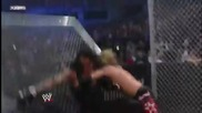 Edge Spears Undertaker throught the Hell in a Cell wall