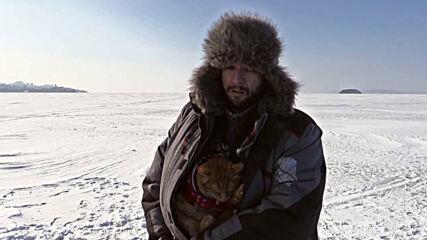 Best fisherman in town - cat accompanies owner on fishing trips in Russia's Far East