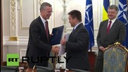 Ukraine: NATO and Kiev officials sign cooperation agreements