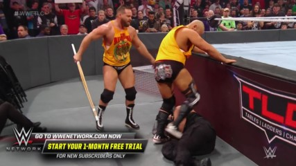 Roman Reigns takes out The Revival with flying leap: WWE TLC 2019