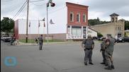 US Fugitives 'spotted Near Prison'