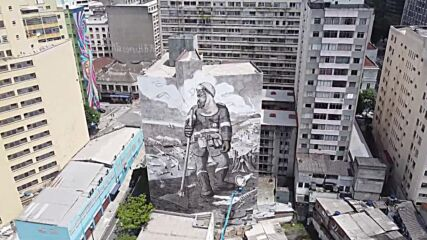 Brazil: Artist creates mural with ashes from Amazon region