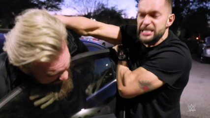 Finn Bálor jumps Trent Seven in a parking lot