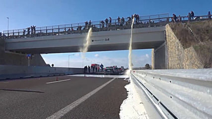 Italy: Sardinian farmers spill MILK on motorway to protest falling prices