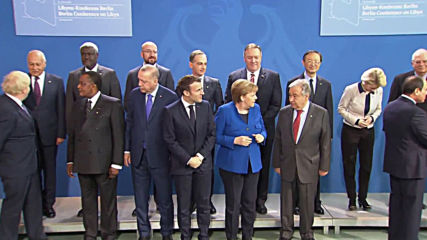 'Where's Putin?' - Group photo delayed as Merkel, Macron search for Russian president