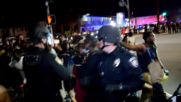 USA: 'Hands up, don't shoot!' - protesters and police standoff after fatal shooting