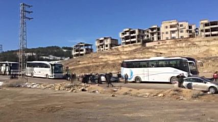 Syria: Militants and civilians evacuated from liberated town in Wadi Barada