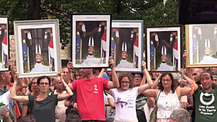 France: Climate activists rally in Bayonne carrying upside down Macron portraits