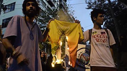 Brazil: National flag burned at Rio anti-Olympics demo
