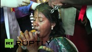 India: Coconuts SMASHED on devotees' heads at Aadi Perukku holy festival