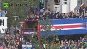 Tens of Thousands of Icelanders Welcome Home National Team with Viking Chant