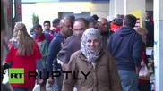 Austria: Refugees board Munich-bound trains in Vienna