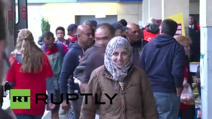 Austria: Refugees board Munich-bound trains in Vienna