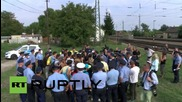Hungary: Grief-stricken refugees refuse police detention