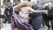 Topless Activists Disrupt Le Pen's May Day Speech