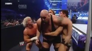 Rhodes, Mcintyre & Ziggler throws Big Show through the Barricade