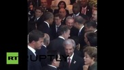 Panama: Obama and Castro share handshake ahead of historic meeting