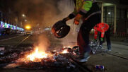 Netherlands: Police and firefighters put out fires, clear debris in the Hague following anti-lockdown protest