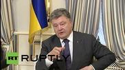 Ukraine: Poroshenko and McCain heap praise on military volunteers