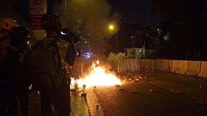 Hong Kong: Protesters vandalise mall and set Christmas tree on fire
