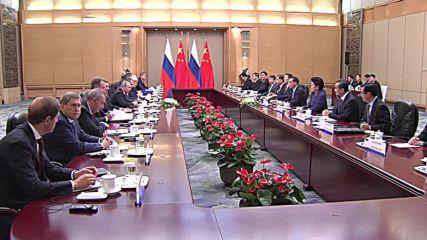 China: Putin praises relations with China on Beijing visit