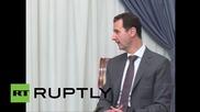 Syria: Iranian FM Zarif and Syrian President Assad meet for peace talks