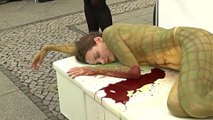 Germany: PETA activist strips off to protest 'blood-soaked fashion'