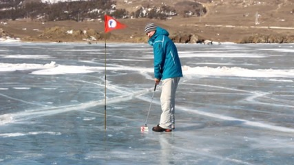 Russia: Ice tee-off! Golfers take to frozen Baikal Lake for Ice Golf Tournament