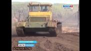 Руски кооператори орат нивите си с танкове