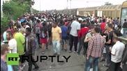 Macedonia: Relieved refugees reach Gevgelija station