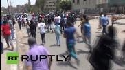 Egypt: Muslim Brotherhood and Morsi sympathisers defy ban, tear gas deployed