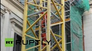"""Spain: Greenpeace hang banner from tower crane to protest """"gag law"""""""