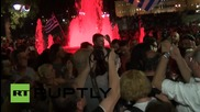 Greece: Parliamentary speaker mobbed by jubilant'OXI' crowds