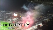 Greece: Dortmund supporters clash with Greek riot police