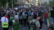 Протестиращи срещу полицаи в Скопие