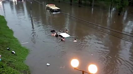 Russia: Flash floods rip through Lipetsk, leaving car and buses submerged