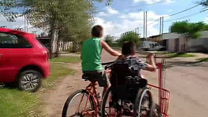 Disabled boy rides bike with cousin thanks to local blacksmith