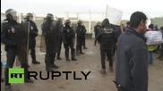 France: Scuffles break out at Calais 'Jungle' camp as police stop refugees leaving