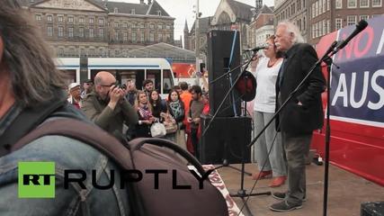 Netherlands: Syriza's Manolis Glezos rouses crowd at Amsterdam anti-austerity demo
