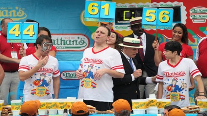 NATHAN'S HOT DOG EATING CONTEST, REIGNING CHAMP CHESTNUT CONSUMED OVER 23,000 CALORIES A YEAR AGO