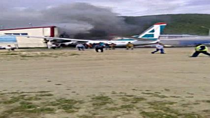 Russia: Emergency services attend scene of An-24 passenger plane crash in Buryatia