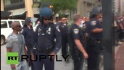 USA: Police wield taser against Freddie Gray protester as pre-trial kicks off for indicted cops