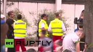 Germany: Refugee threatens to jump from 10-storey registration centre in protest