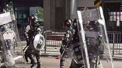 Hong Kong: Unrest continues as riot police and PolyU students face off