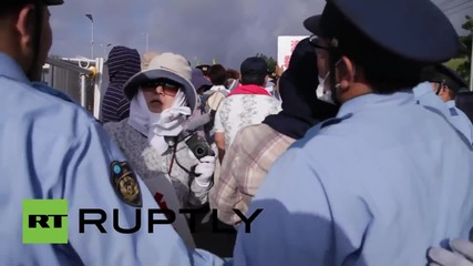 Japan: Scuffles break out bewteen police and anti-US abse protesters at Camp Schwab
