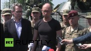 Ukraine: Yatsenyuk rides atop BTR-70, inspects drones as US troops train in Lviv
